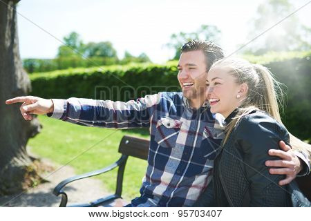 Laughing Affectionate Couple In The Park