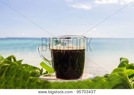 Black Coffee With View On The Beach And Blue Sky