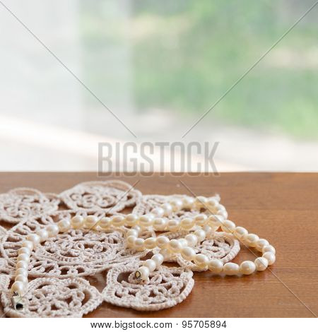 Pearl Necklace On A Lacy Napkin
