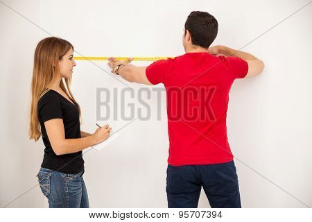 Couple Taking Some Measurements
