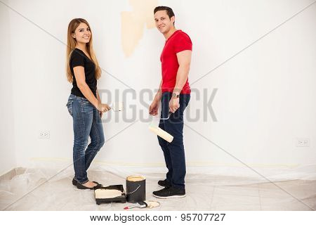 Married Couple Painting A Room