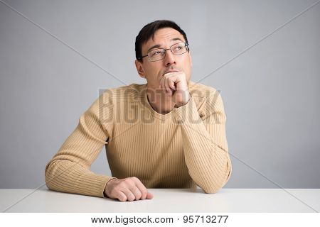 Handsome Man On A Desk Thinking