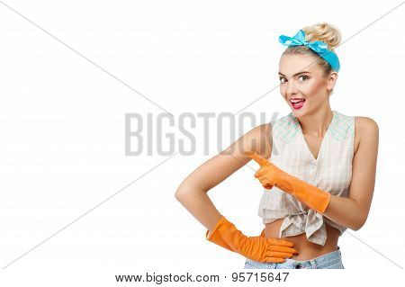 Cheerful young girl is cleaning her house