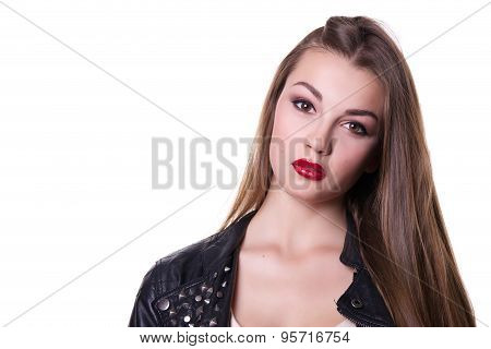 Beautiful girl with a red lipstick dressed in a black leather jacket. Isolated over white background