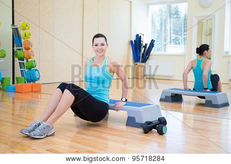 Happy Beautiful Slim Woman Working Out With Stepper In Gym