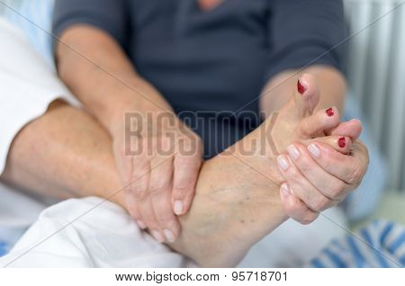 Senior Lady Massaging Her Foot