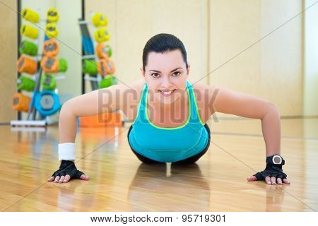Beautiful Woman Doing Push Up Exercise In Gym