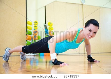 Beautiful Sporty Woman Doing Push Up Exercise In Gym