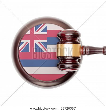Wooden judge gavel with US state flag on sound block - Hawaii