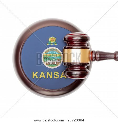 Wooden judge gavel with US state flag on sound block - Kansas