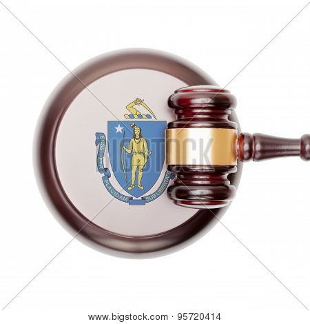 Wooden judge gavel with US state flag on sound block - Massachusetts