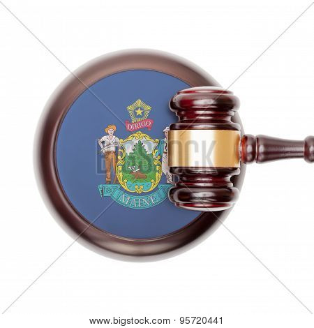 Wooden judge gavel with US state flag on sound block - Maine