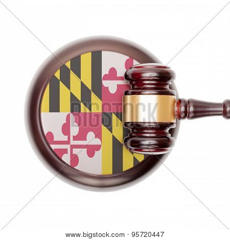 Wooden judge gavel with US state flag on sound block - Maryland