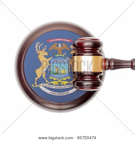 Wooden judge gavel with USA state flag on sound block - Michigan