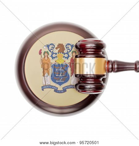 Wooden judge gavel with US state flag on sound block - New Jersey