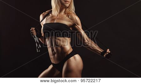 Confident young muscular fitness female