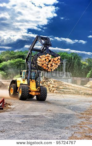 Forklift Truck Hauling Logs At Sawmill