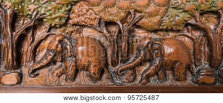 Vintage wooden carve elephant in forest