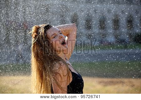 Young woman enjoys a refreshment in the city