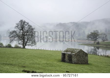 Landscape On Misty Morning Of Fields Around Lake Windermere In Lake District