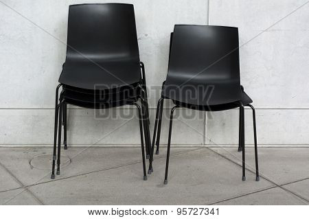 Stack Of Black Chairs