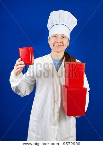 Female Cook   With   Three Red  Packages