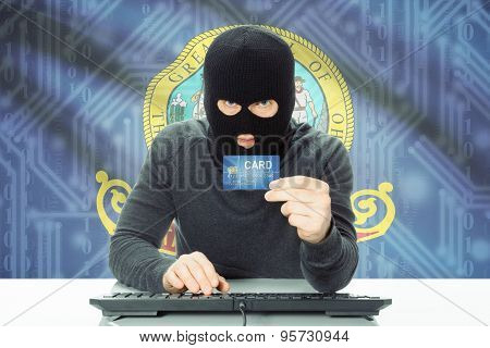 Hacker Holding Credit Card And Usa State Flag On Background - Idaho