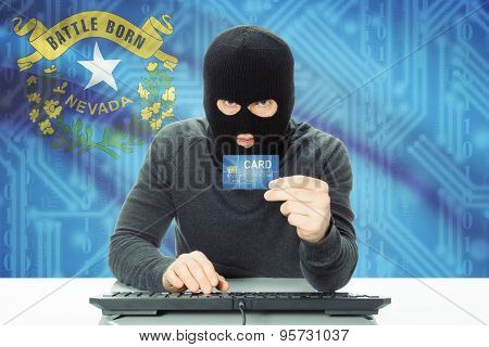 Hacker Holding Credit Card And Usa State Flag On Background - Nevada