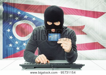 Hacker Holding Credit Card And Usa State Flag On Background - Ohio