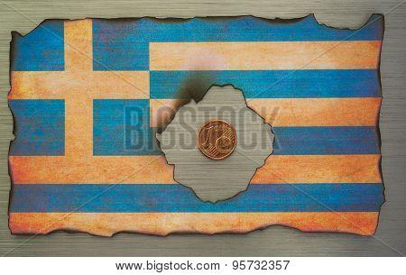 burnt greek flag on brushed metal background