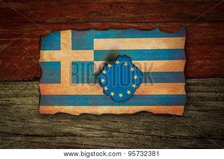 European flag behind burnt Greek flag background
