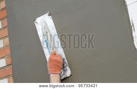 The Process Of Applying Putty With A Spatula
