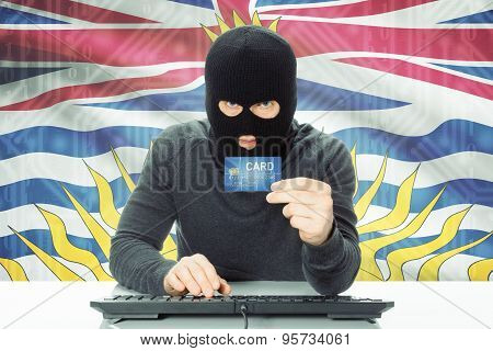 Hacker Holding Credit Card And Canadian Province Flag On Background - British Columbia