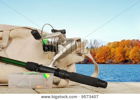 spinning fishing equipment on a dock in the autumn