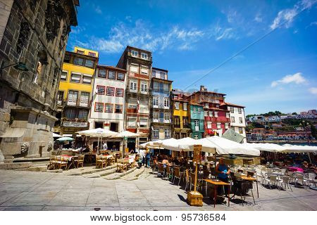 PORTO, PORTUGAL - JUNE, 11: Tourists visit restaurants at famous place Ribeira Square on June 11, 2015 in Porto, Portugal
