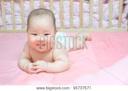 Asian Baby Girl Scowl On Pink Bed