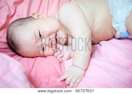 Asian Baby Girl Crying On Pink Bed
