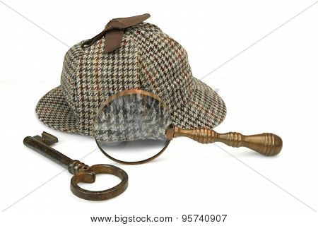 Sherlock Holmes Deerstalker Cap, Vintage Magnifying Glass And Old Key