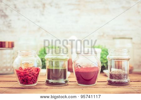 Goji,chia, Aroina And Spirulina (superfood) On Wooden Tabe
