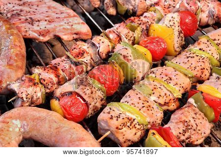 Assorted Roasted Meat With Vegetable On Barbecue Flaming Grill