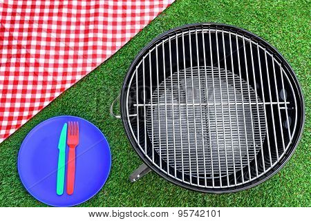 Picnic Tablecloth, Plate, Fork, Knife, Bbq Grill  On The Lawn