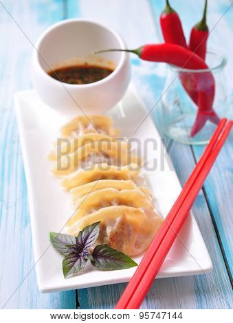 Fried asian wonton with soy sauce