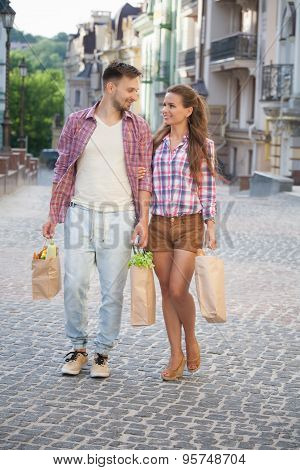 Young couple with products
