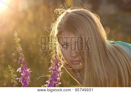 Beautiful Blonde And Flowers At Sunset