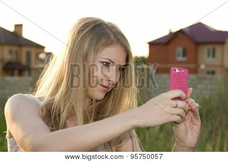 Pretty Girl Photographing Herself