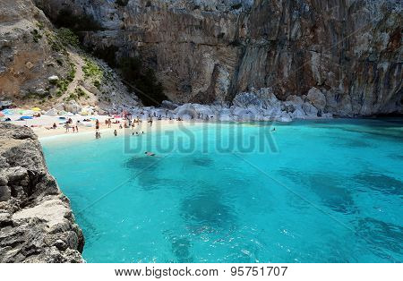 CALA MARIOLU, BAUNEI, ITALY - JULY 01, 2015: People on one of the beautiful beach in Sardinia, Italy