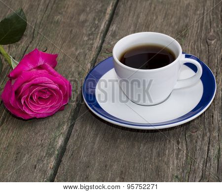 Cup Of Black Coffee And Rose On The Old Desktop
