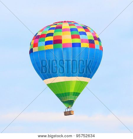 Colorful hot air balloon on the sky. Digital artwork of fictional vehicle on aviation theme.
