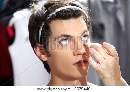 Makeup Artist Applying Foundation With A Sponge, Man In The Dressing Room Mirror
