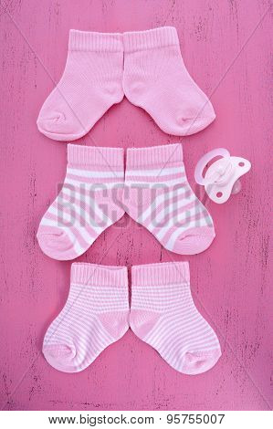 Its A Girl Baby Shower Or Nursery Concept With Socks On Pink Wood